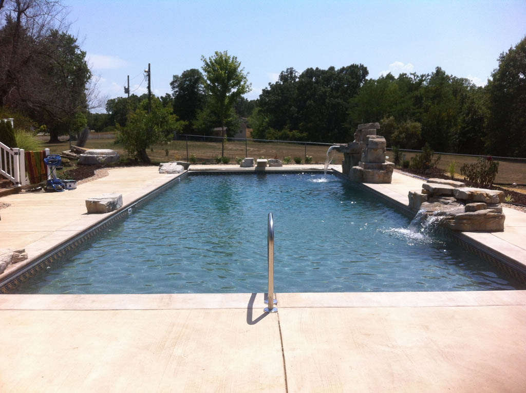 rectangle pool with two fountains and diving board - JNR Pools